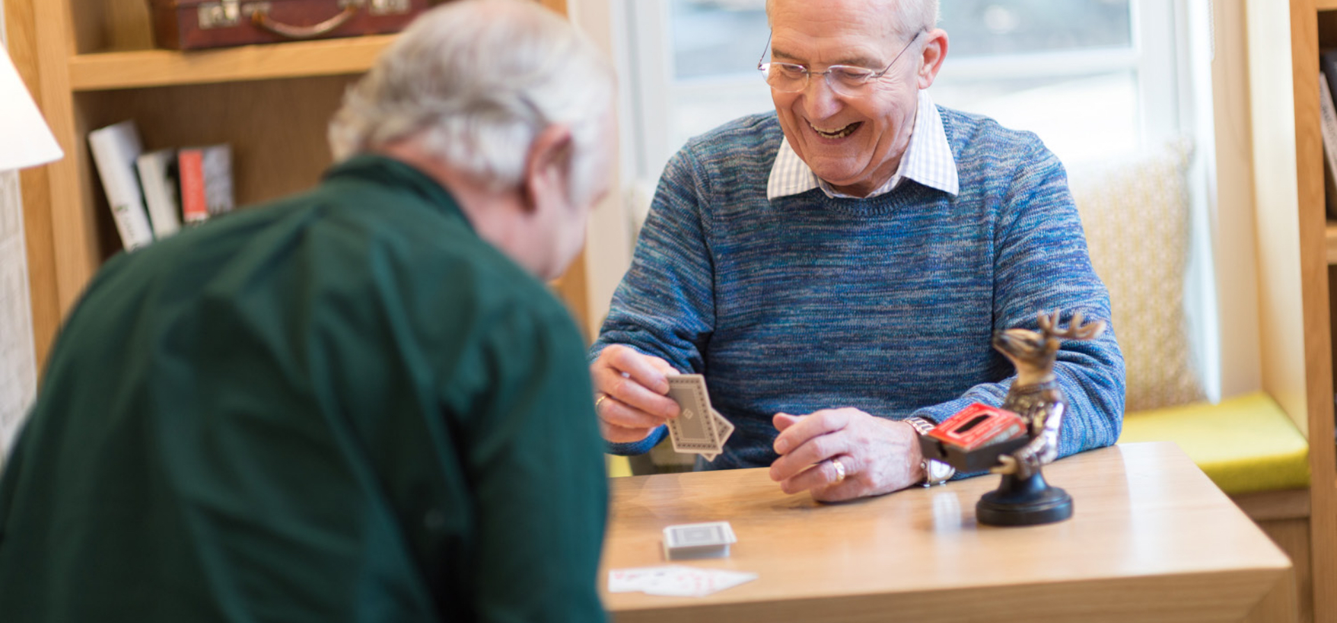 two majesticare residents playing cards in luxury care home